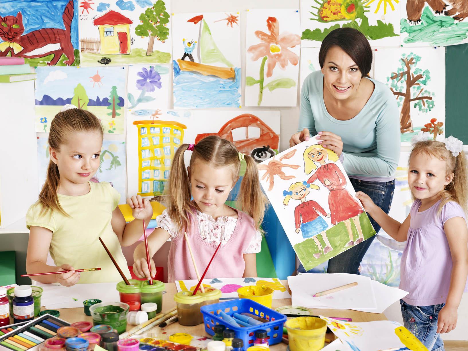 Children with teacher at school.